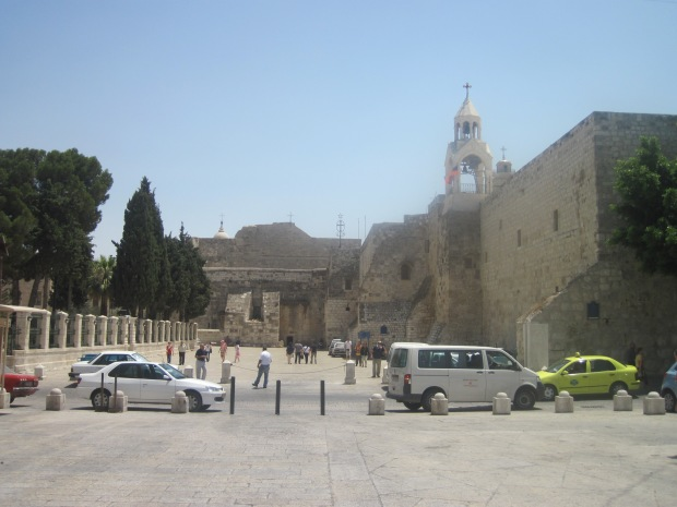 The Church of the Nativity in Bethlehem.  The wire star above and to the right of the doorway marks the spot under which Jesus Christ was born (Taken by me August 3, 2011).